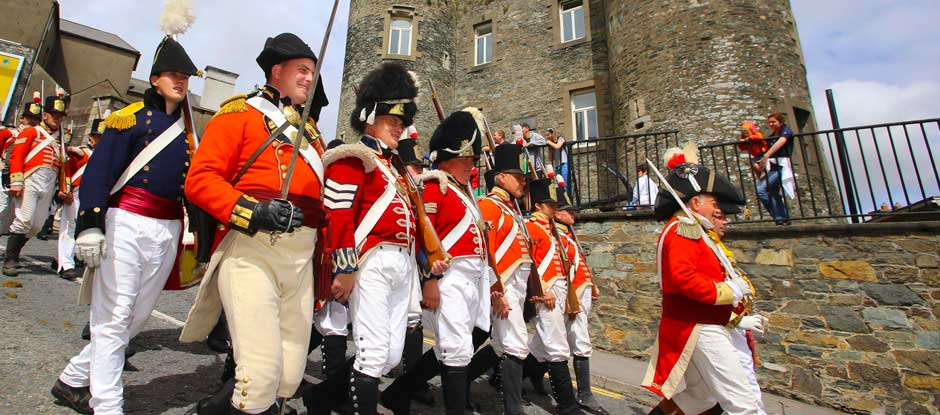 Soldiers marching past Enniscorthy Castle